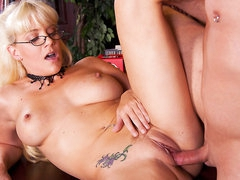 Blonde haired four-eyed milfy librarian Heidi Mayne has a nice time egtting her hairless neat pussy fucked by horny hard dicked dude after she blows his dick. She has hawt tattoos all over her hot body.