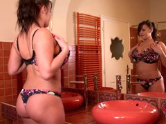 Leanne Crow is a sexy curvy brunette with big breasts and juicy ass. She poses in front of the mirror in her lingerie. She looks great in bra and panties.