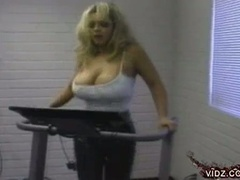 Blondie with huge tits plays with pussy alone