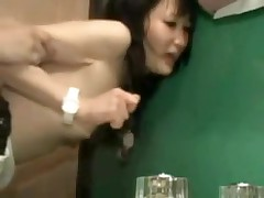 Asian couple in bathroom