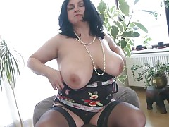 busty mature lady showing off and masturbating