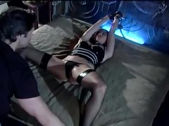 Servitude and sex in a rubber corset and stockings